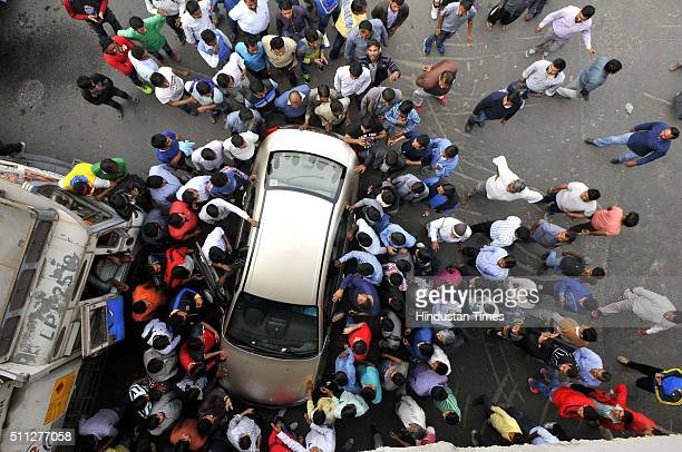 Members of the Jat community protest, as they block the road at Netaji Subhash Chowk for reservations in government services, on February 19, 2016 in...