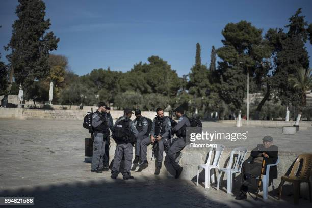 Members of the Jerusalem Waqf department police force stand by the AlAqsa Mosque on the Temple Mount in the Old City in Jerusalem Israel on Sunday...