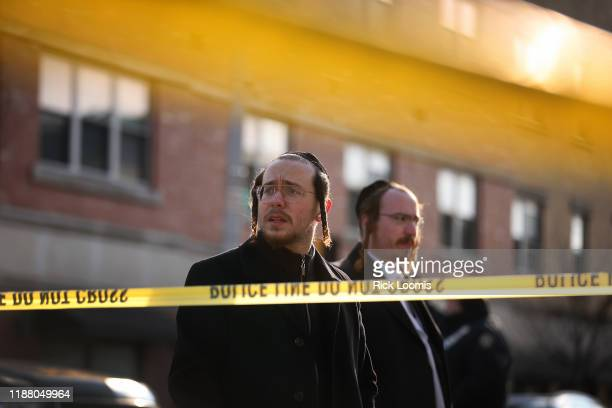 Members of the Jewish community gather around the JC Kosher Supermarket on December 11, 2019 in Jersey City, New Jersey. Six people, including a...