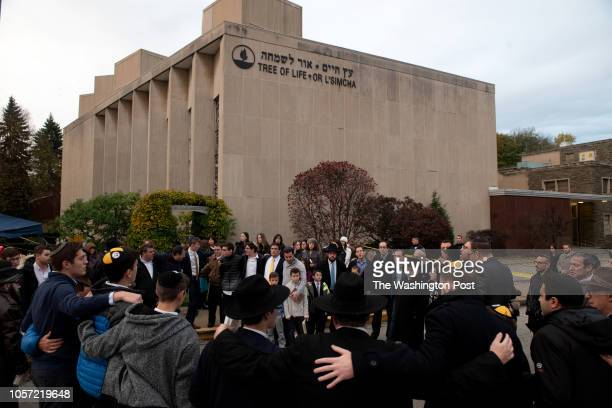 Members of the Jewish community gather in front of the Tree of Life Synagogue for the Shabbat on Friday evening November 2 2018 in Pittsburgh's...