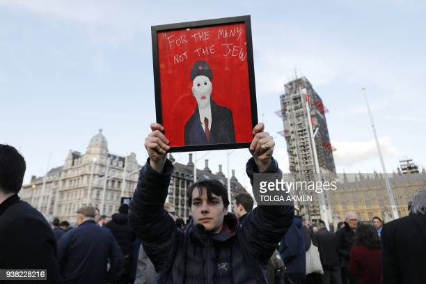 TOPSHOT Members of the Jewish community hold a protest against Britain's opposition Labour party leader Jeremy Corbyn and antisemitism in the Labour...