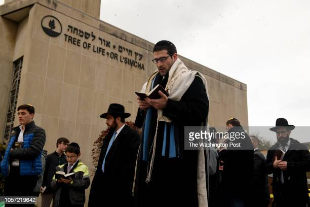 Members of the Jewish faith gather in front of the Tree of Life Synagogue for the Shabbat on Friday evening, November 2, 2018 in Pittsburgh's...