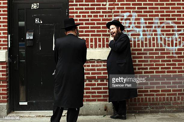 Members of the Jewish Orthodox community talk on a street in a Brooklyn neighborhood on June 14 2012 in New York City According to a new study by...