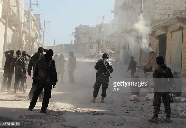 Members of the jihadist group AlNusra Front fire homemade mortar rounds during fighting with goverment forces on February 8 2014 in the Syrian...