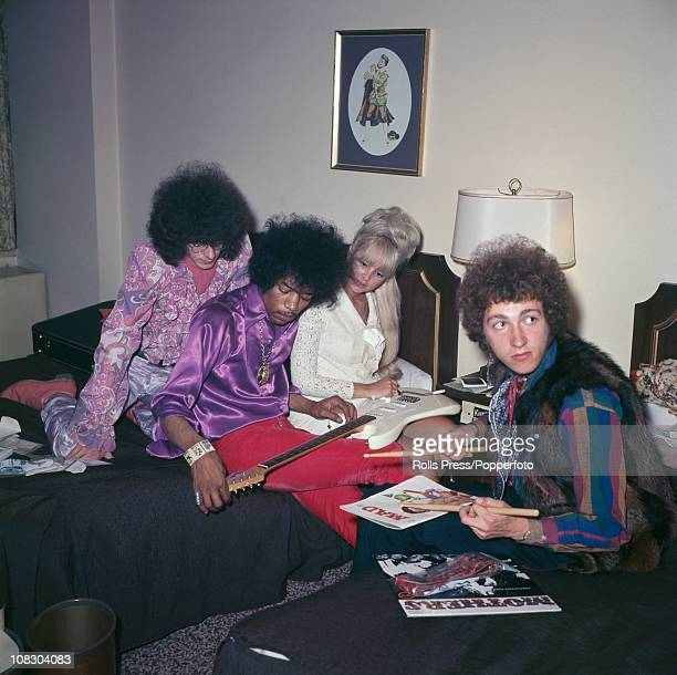 Members of The Jimi Hendrix Experience with a blonde lady circa 1968