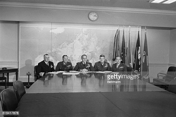 Members of the Joint Chief of Staff and General DM Shoup Commandant US Marine Corps pose for photographers in their conference room at the Pentagon...