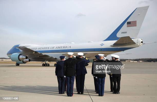 Members of the Joint Chiefs salute as a US Air Force 747 that is being called 'Special Mission 41' takes off carrying the casket of former US...