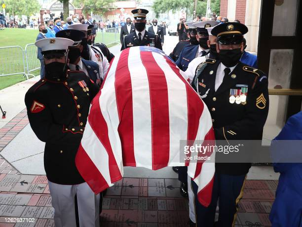 Members of the joint services military honor guard carry the casket of Rep. John Lewis into the Ebenezer Baptist Church on July 30, 2020 in Atlanta,...