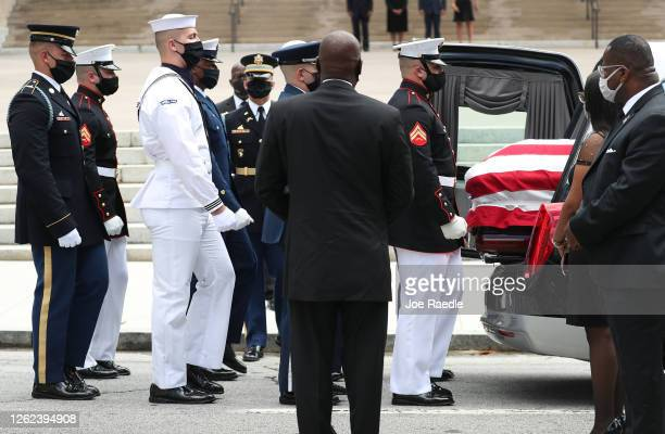 Members of the joint services military honor guard prepare to carry the casket of Rep. John Lewis to the Georgia State Capitol on July 29, 2020 in...