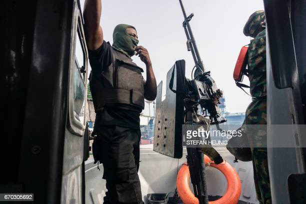 Members of the Joint Task Force, Operation Delta Safe , prepare to go on patrol in the creeks looking for illegal oil refineries on April 19, 2017 in...