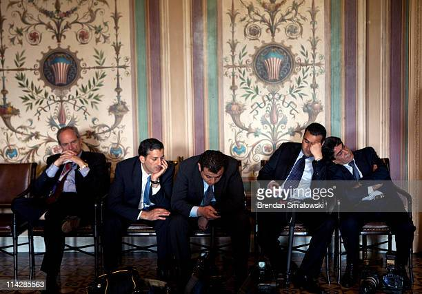 Members of the Jordanian press and others wait for a meeting between Jordan's King Abdullah and the Senate Foreign Relations Committee on Capitol...