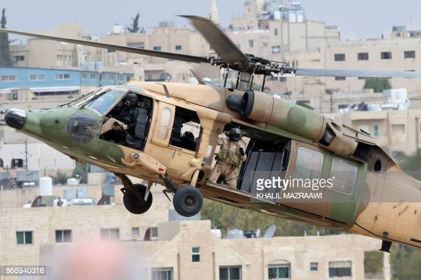 Members of the Jordanian Special Forces demonstrate tactical maneuvers with a Sikorsky UH60 Black Hawk helicopter in midair during a hostage...