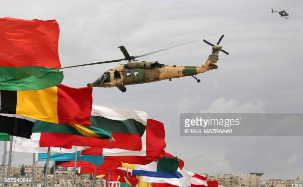 Members of the Jordanian Special Forces demonstrate tactical maneuvers with a Sikorsky UH60 Black Hawk helicopter during a hostage simulation in the...