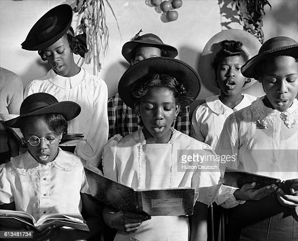 Members of the junior choir sing hymns at Commandant Keeper's congegation church in Harlem New York