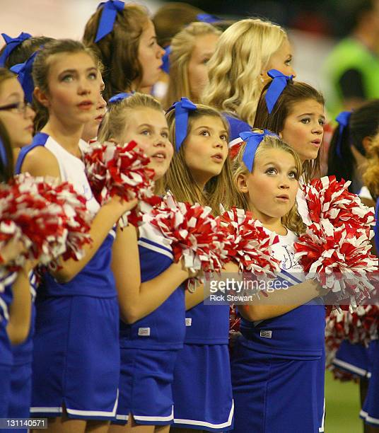 Members of the Junior Jills cheerleaders sing the national anthem of Canada prior to play between the Buffalo Bills and Washington Redskins at Rogers...