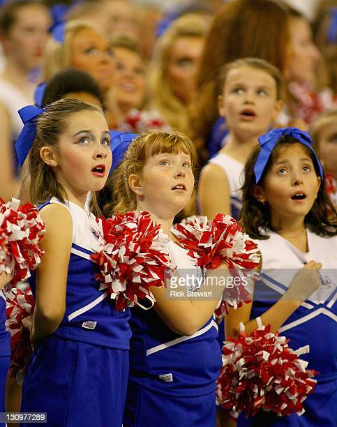 Members of the Junior Jills cheerleaders sing the national nthem of Canada prior to play between the Buffalo Bills and Washington Redskins at Rogers...