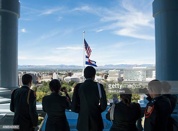Members of the Junior ROTC program at West High School look out from the newly reopened observation deck at the Colorado State Capitol building...