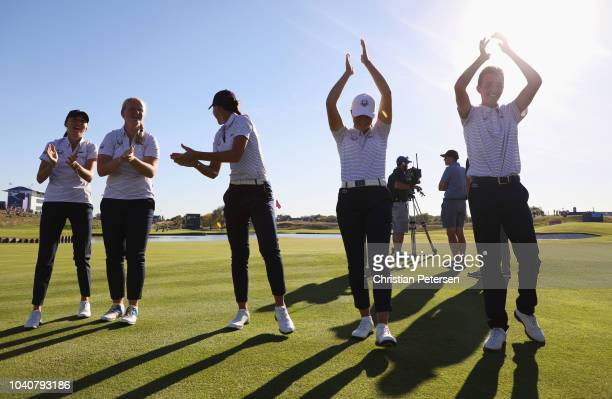 Members of The Juniors Ryder Cup teams celebrate following the Junior Ryder Cup GolfSixes ahead of the 2018 Ryder Cup at Le Golf National on...