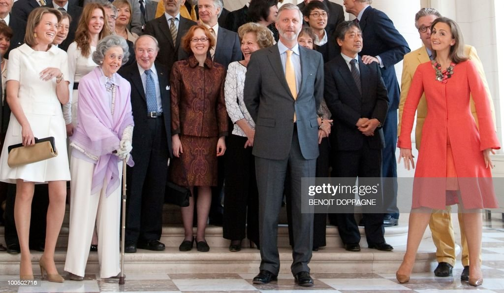 Members of the jury and (Front L-R) Belgium's Princess Mathilde, Queen Fabiola, Prince Philippe, Prince Laurent and Princess Claire pose for a family picture prior to lunch with the jury members of the Queen Elisabeth International Music Competition - Piano 2010, at the Royal palace in Brussels on May 25, 2010.