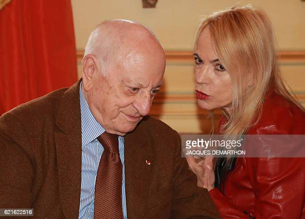 Members of the jury French businessman Pierre Berge and French writer and journalist Laure Adler speak together after announcing the winner of this...