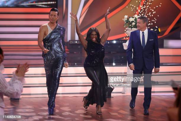 Members of the jury Jorge Gonzalez Motsi Mabuse and Joachim Llambi enter the dance floor during the 3rd show of the 12th season of the television...