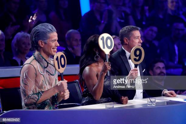 Members of the jury Jorge Gonzalez, Motsi Mabuse and Joachim Llambi gives 29 points to Vanessa Mai and Christian Polanc during the 1st show of the...