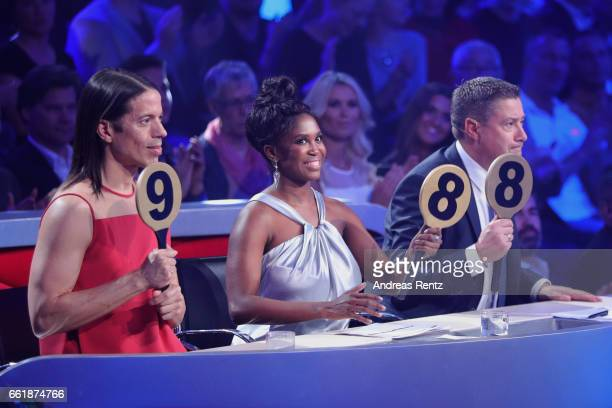Members of the jury Jorge Gonzalez Motsi Mabuse and Joachim Llambi gives 25 points to Heinrich Popow and Kathrin Menzinger during the 3rd show of the...
