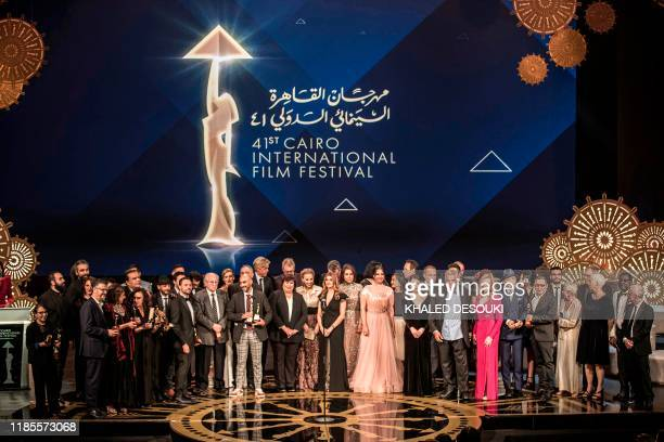 Members of the jury of the 41st edition of the Cairo International Film Festival pose for a group photo with award winners at the conclusion of the...