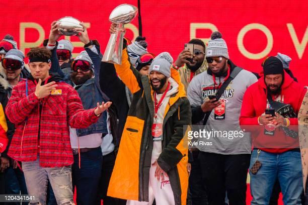 Members of the Kansas City Chiefs celebrate on stage during the Kansas City Chiefs Victory Parade on February 5 2020 in Kansas City Missouri