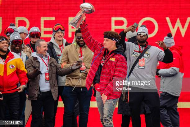 Members of the Kansas City Chiefs celebrate on stage with the Vince Lombardi Trophy during the Kansas City Chiefs Victory Parade on February 5 2020...