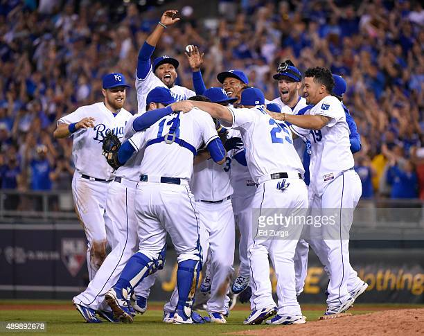 Members of the Kansas City Royals celebrate after taking the American League Central Division title at Kauffman Stadium on September 24, 2015 in...