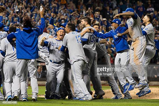 Members of the Kansas City Royals celebrate on the field after defeating the New York Mets in Game 5 of the 2015 World Series at Citi Field on Sunday...