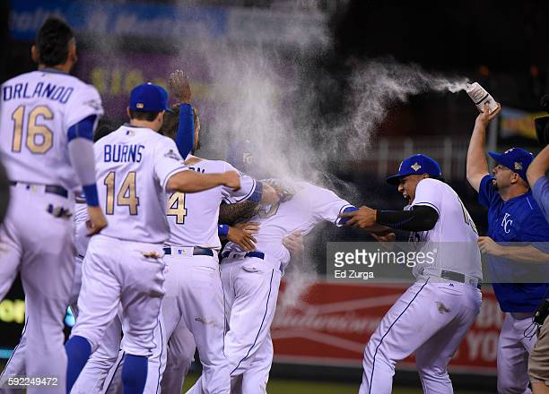 Members of the Kansas City Royals congratulate Eric Hosmer of the Kansas City Royals after Hosmer hit a walkoff single against the Minnesota Twins in...