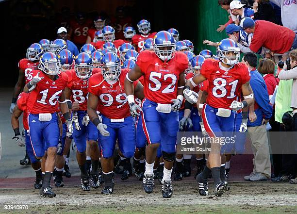 Members of the Kansas Jayhawks run onto the field prior to their game against the Missouri Tigers during the game at Arrowhead Stadium on November 28...