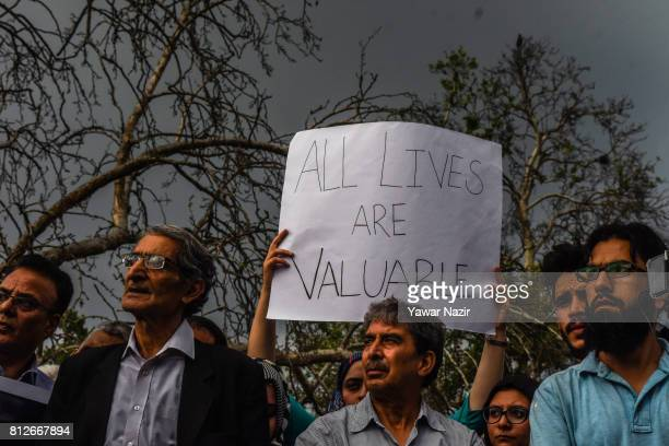 Members of The Kashmir Civil Society hold placards during a protest demonstration against yesterday's attack on Hindu pilgrims in south Kashmir by...