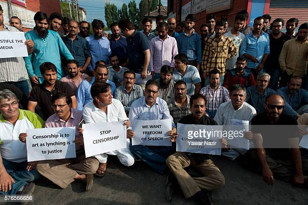 Members of the Kashmir media stage a sitin protest against curbs imposed by the Indian government on July 16 2016 in Srinagar the summer capital of...