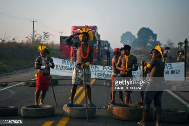 Members of the Kayapo tribe block the BR163 highway during a protest outside Novo Progresso in Para state, Brazil on August 17, 2020. - Indigenous...