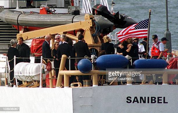 Members of the Kennedy and Bessette families including Senator Ted Kennedy gather at the stern of the Coast Guard ship Sanibel as they prepare to...