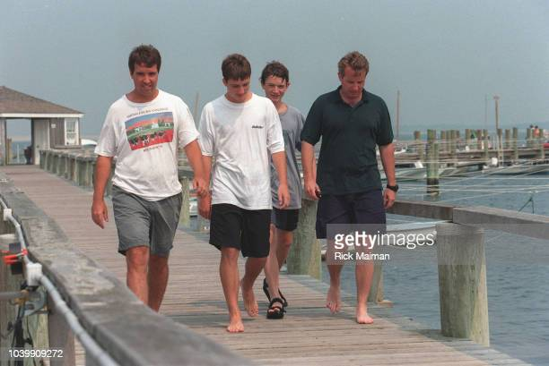 Members of the Kennedy family including William Kennedy Smith and John Fitzgerald Kennedy Jr gather in Hyannis Port Massachusetts to await news after...