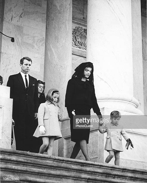 Members of the Kennedy family leave the US Capitol follwing a brief service leaving the body of assassinated President John F Kennedy where it will...