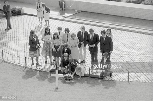 Members of the Kennedy family placed flowers and prayed at the grave of Robert F Kennedy on the seventh anniversary of the assassination of the...