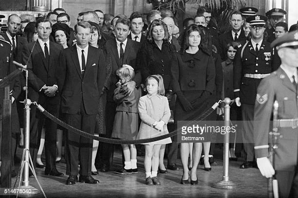 Members of the Kennedy family stand together in grief at the Capitol Rotunda listening to the eulogy given for the late President John F Kennedy on...