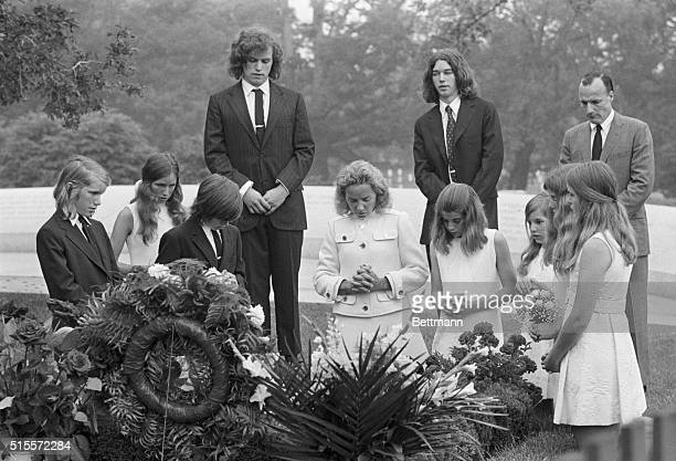 Members of the Kennedy family visit the gravesite of Senator Robert Kennedy on the anniversary of his death From left David Anthony Kennedy Victoria...