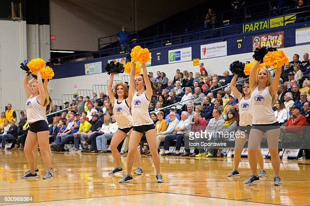Members of the Kent State Dance Team perform during a timeout during the second half of the NCAA Men's Basketball game between the Ball State...