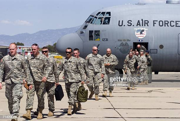 Members of the Kentucky National Guard 206th Engineer battalion arrive on a C130 Hercules transport plane July 11 2006 in Tucson Arizona One hundred...