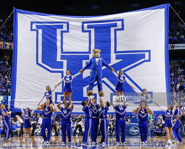 Members of the Kentucky Wildcats cheerleading team pose in front of the University of Kentucky flag during the game against the Alabama Crimson Tide...