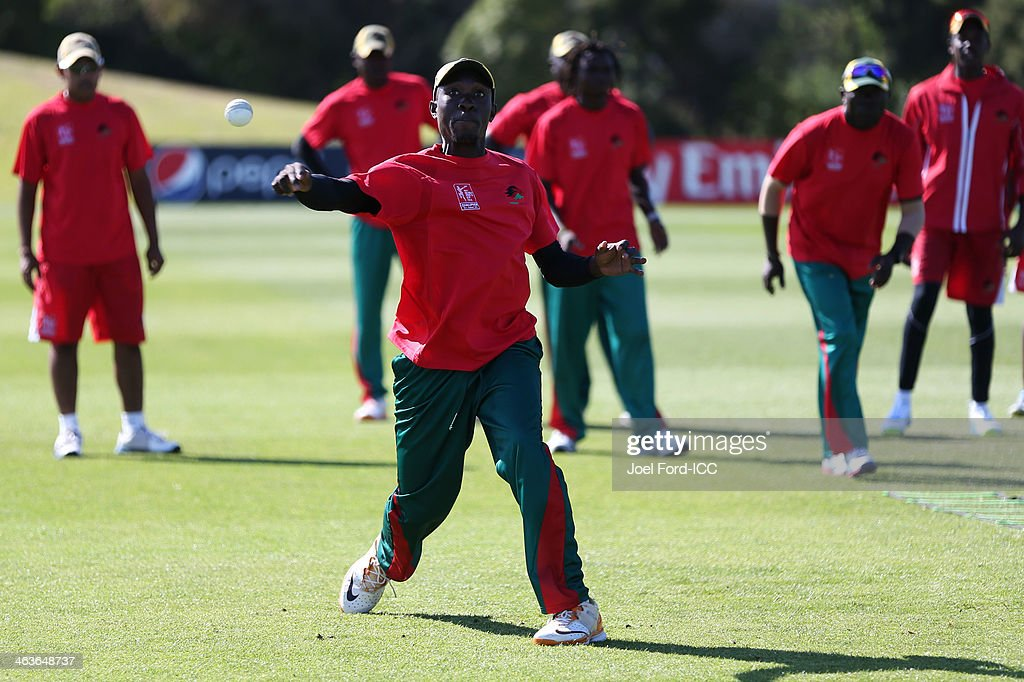 Members of the Kenya cricket team warm-up prior to an ICC World Cup qualifying match against Uganda on January 19, 2014 in Mount Maunganui, New Zealand.