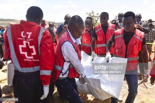 Members of the Kenya Red Cross carry victims' bodies after a Cessna 206 light aircraft crashed at Londiani in Kericho district some 220 km northwest...