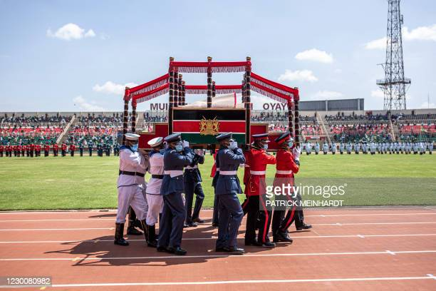 Members of the Kenyan Armed Forces carry the presidential podium during the Independence Day ceremony, called Jamhuri Day at Nyayo National Stadium...