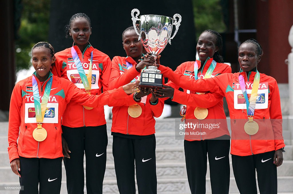 Members of the Kenyan winning team (L-R) Caroline Rotich, Irene Jerotich Kosgei, Silver medalist Priscah Jeptoo, gold medalist Edna Ngeringwony Kiplagat and bronze medalist Sharon Jemutai Cherop pose with the team trophy and their medals after competing in the women's marathon during day one of the 13th IAAF World Athletics Championships at the Daegu Stadium on August 27, 2011 in Daegu, South Korea.